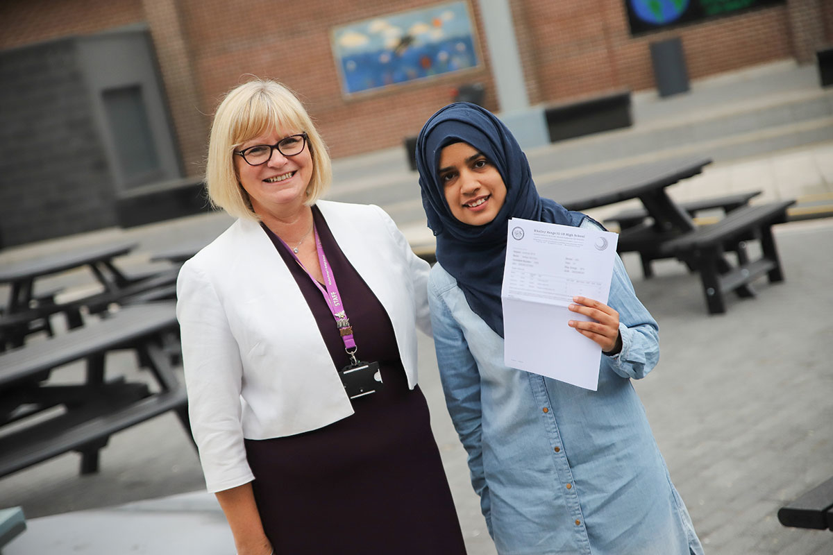 Mrs J. Lomax, Head of Sixth Form (Sep 2018 - Aug 2020) with Nafisa (right). With 3 B's, Nafisa will be be going on to study history and modern politics at The University of Manchester