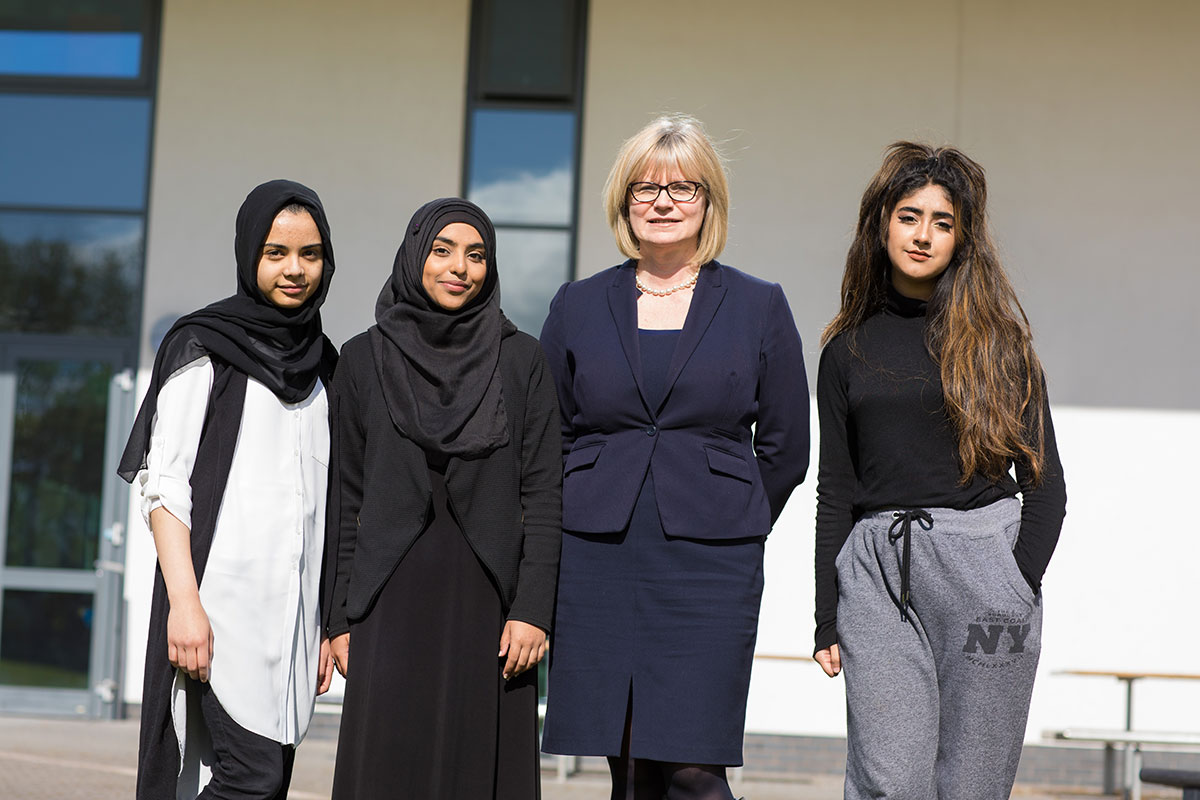 Mrs J Lomax, Head of Sixth Form with Sixth Form students