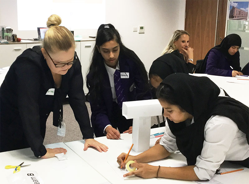 Students design a tower block as part of a challenge day at Lovell in Manchester in 2019