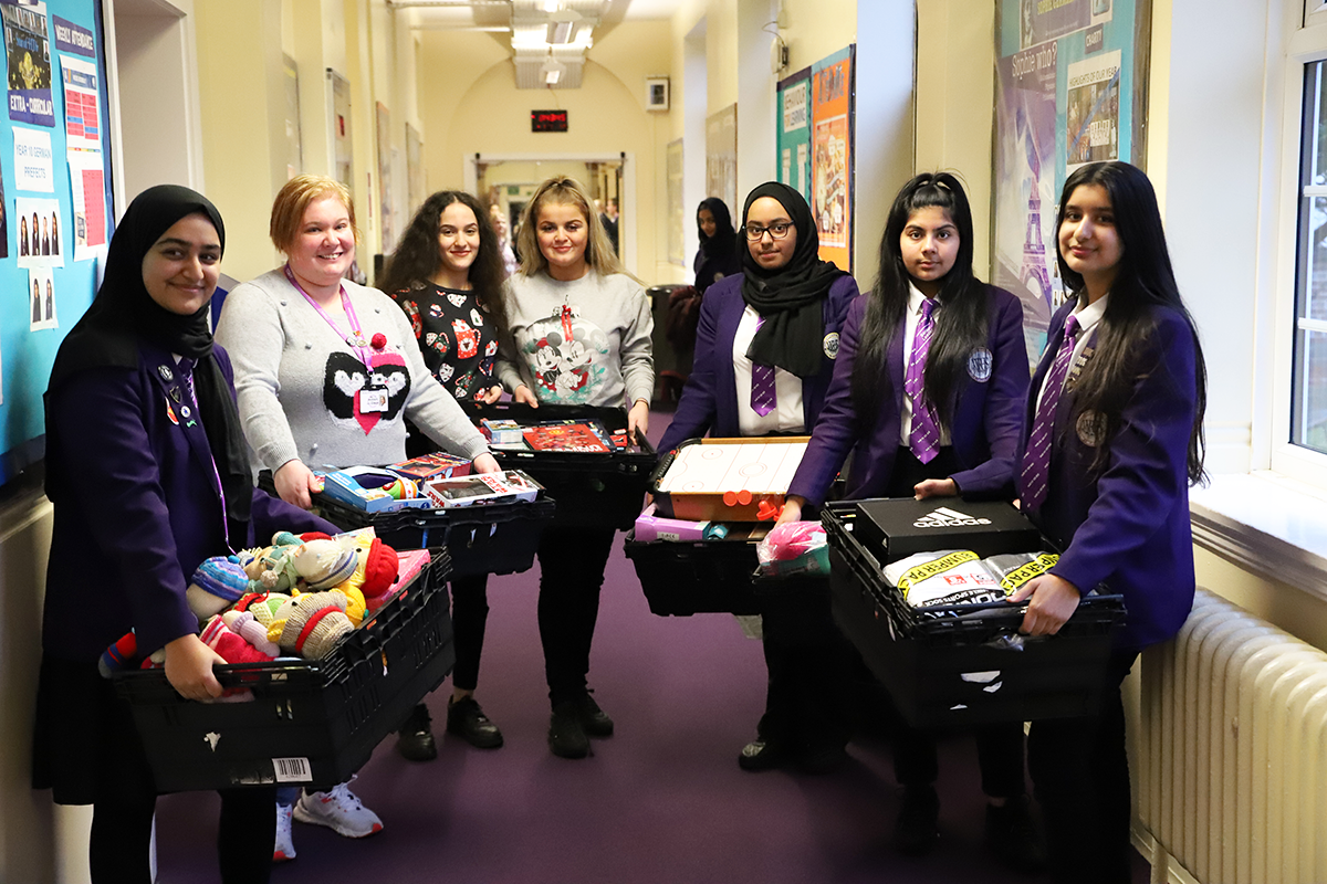 Students and Mrs Mackenzie preparing gifts for the Wood Street Mission toy appeal in December 2019